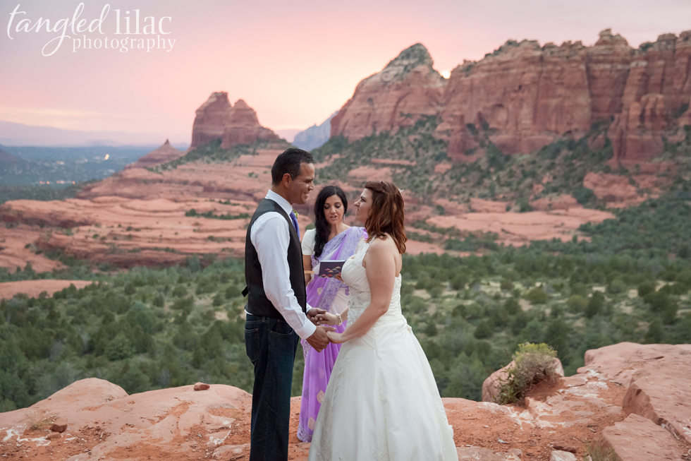 A couple getting married at Marry Go Round Rock in Sedona at sunet