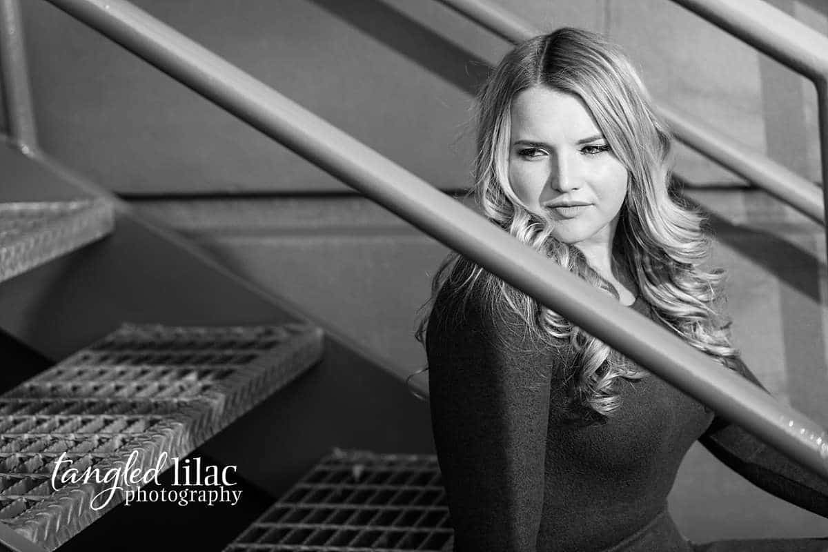 Moody black and white senior student photographed on stairs in Malibu California while looking away located in Thousand Oaks Senior Photographer