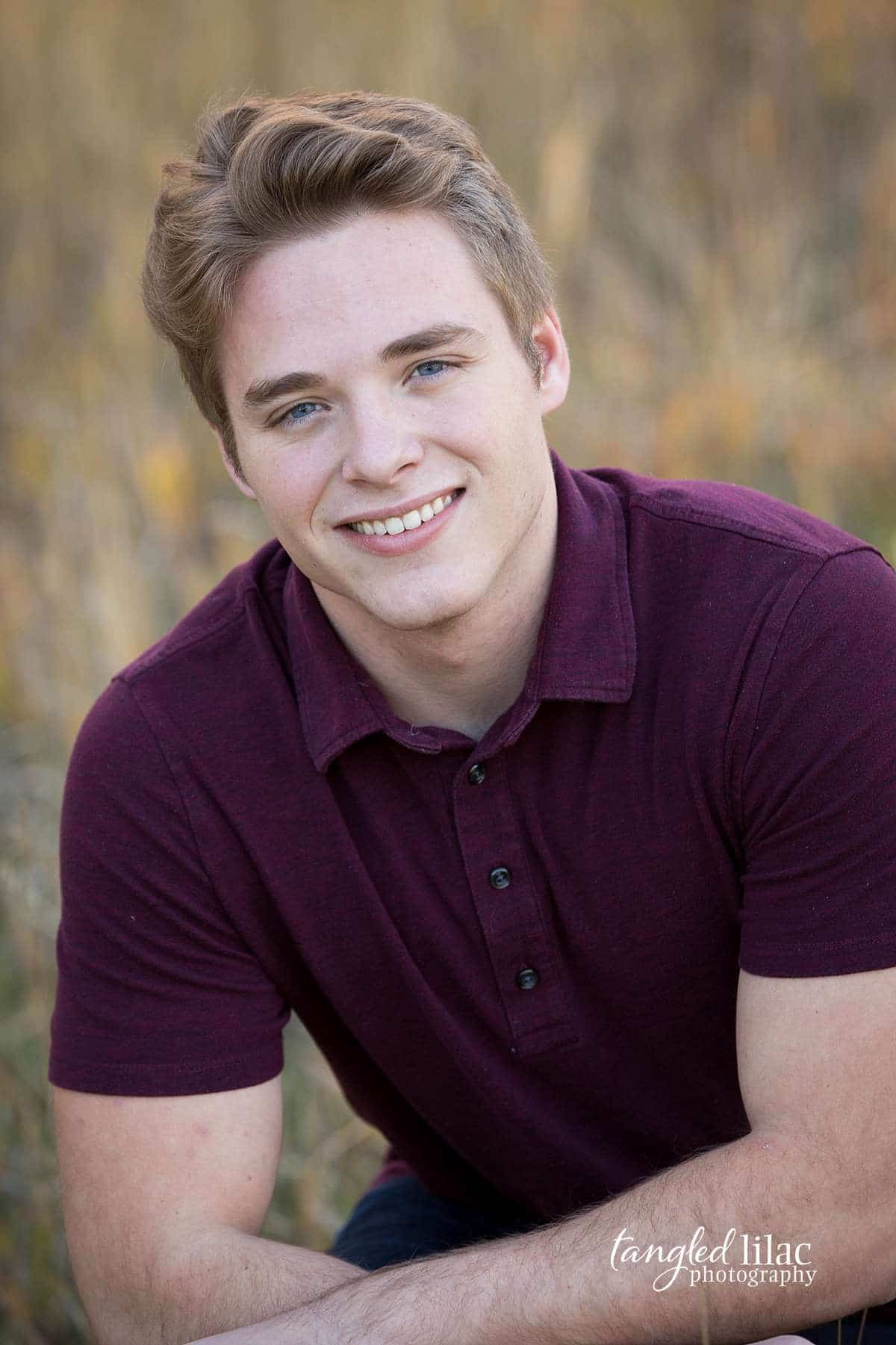 High School Senior Boy doing senior photography during the fall with colors