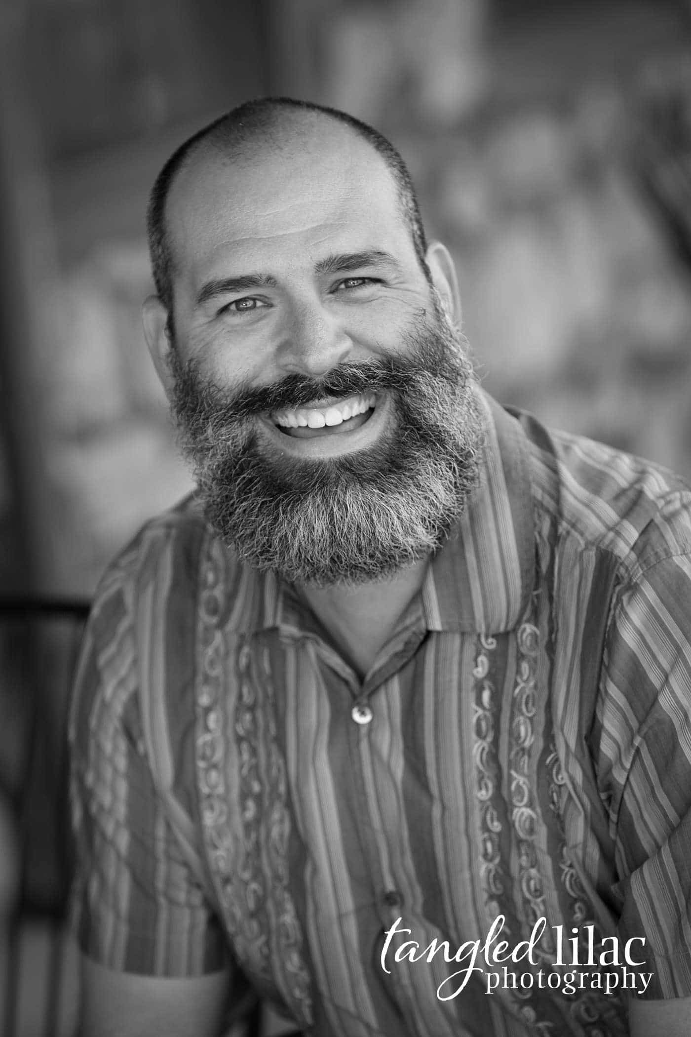 Black and white portrait of a real estate agent during his headshots in Flagstaff Arizona taken by Melissa Dunstan who is a Headshot photographer