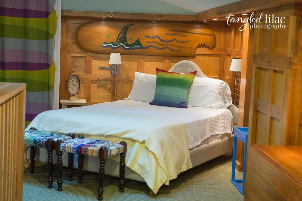 Cottage Bedroom with surfboard by real estate photographer Melissa Dunstan