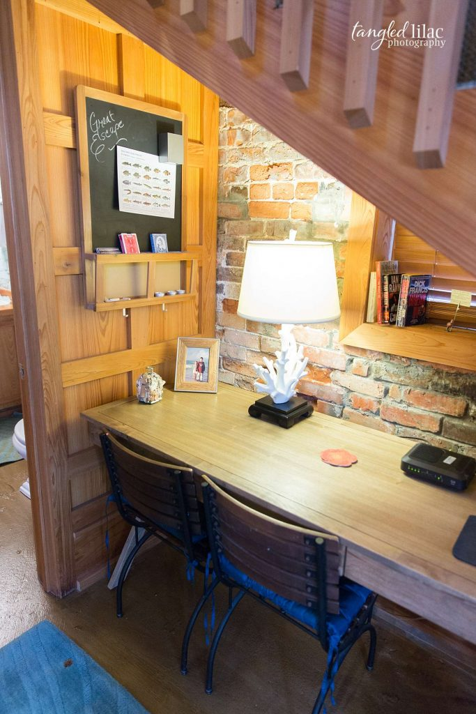 hidden desk under the stairs in quaint cottage by real estate photographer melissa dunstan