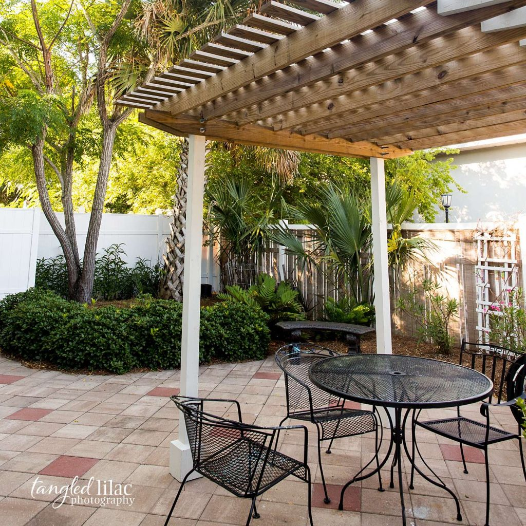 outdoor patio with iron patio set by real estate photographer tangled lilac