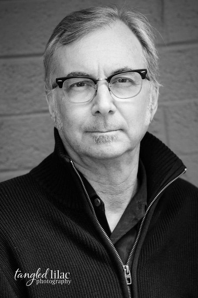 Black and White headshot image of an english professor by melissa dunstan headshot photographer